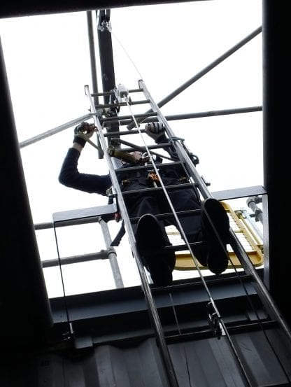 Man working at height on a ladder